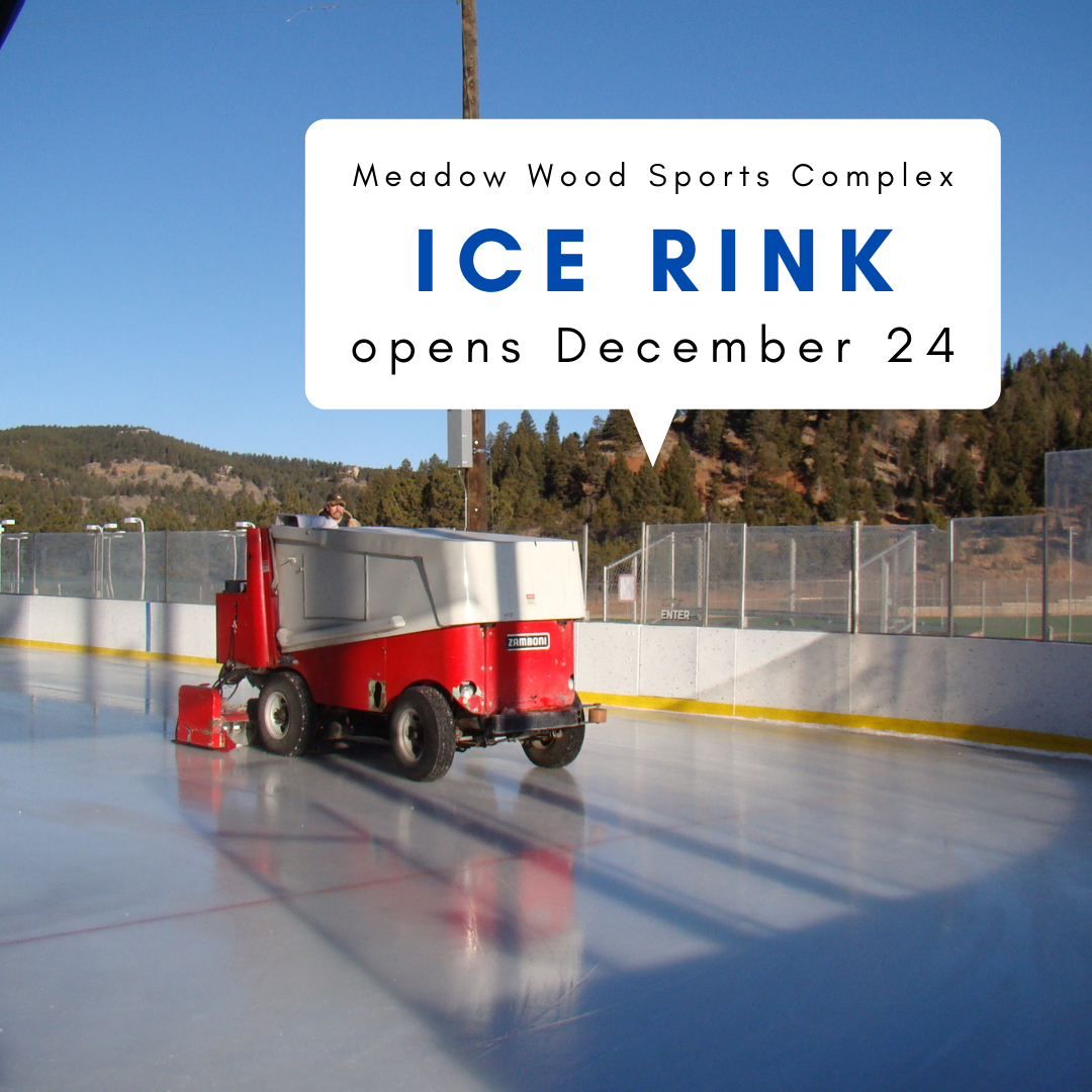 man driving a zamboni on ice rink